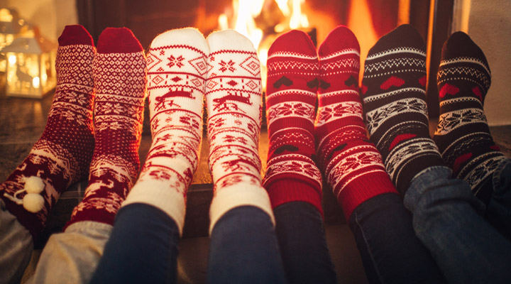 Holiday socks by fireplace